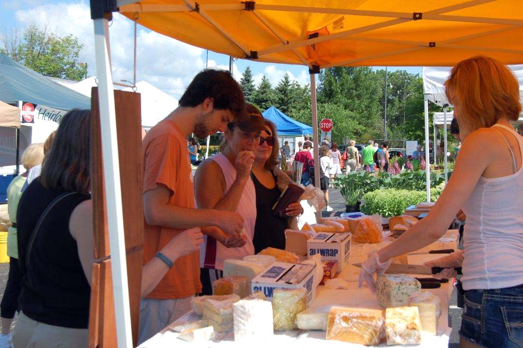 Customers at the cheese stand